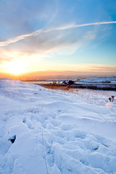 Sunset over a snow-covered Scout Moor, near Ramsbottom.